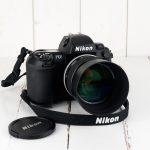 nettoyage du dos collant sur Nikon F100